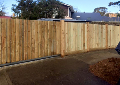 Vertical Timber Panels with Timber Feature Columns and an Automated Electric Sliding Gate