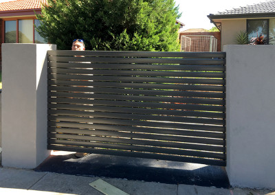 Steel Fence with Rendered Colums and Automated Electric Sliding Gate