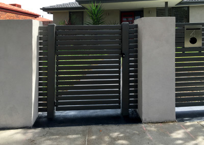 Steel Fence with Rendered Colums and Automated Electric Sliding Gate and Hinged Access Gate