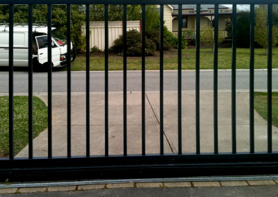 Horizontal Cedar Fence with Automatic Steel Electric Gate